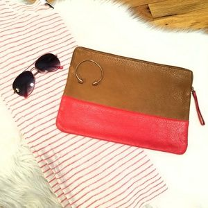 Leather camel and red clutch with gold zipper.